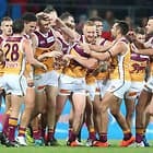 GOLD COAST, AUSTRALIA - AUGUST 18:  Harris Andrews of the Lions celebrates a goal with team mates during the round 22 AFL match between the Gold Coast Suns and Brisbane Lions at Metricon Stadium on August 18, 2018 in Gold Coast, Australia.  (Photo by Chris Hyde/Getty Images/AFL Media)