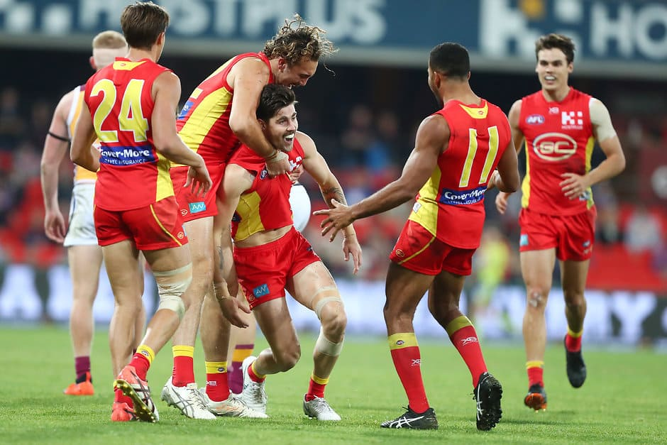 GOLD COAST, AUSTRALIA - AUGUST 18:  Alex Sexton of the Suns celebrates a goal during the round 22 AFL match between the Gold Coast Suns and Brisbane Lions at Metricon Stadium on August 18, 2018 in Gold Coast, Australia.  (Photo by Chris Hyde/Getty Images/AFL Media)