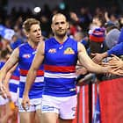 MELBOURNE, AUSTRALIA - AUGUST 19:  Tory Dickson of the Bulldogs high fives fans after winning the round 22 AFL match between the Carlton Blues and the Western Bulldogs at Etihad Stadium on August 19, 2018 in Melbourne, Australia.  (Photo by Quinn Rooney/Getty Images/AFL Media)