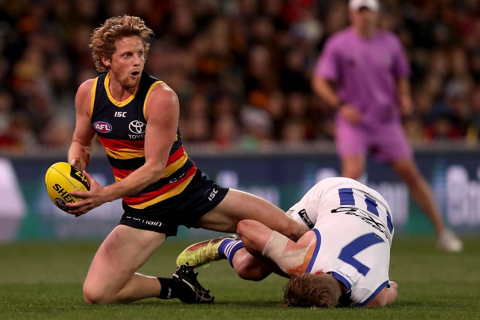 ADELAIDE, AUSTRALIA - AUGUST 19: Rory Sloane of the Crows is tackled by Jack Ziebell of the Kangaroos during the 2018 AFL round 22 match between the Adelaide Crows and the North Melbourne Kangaroos at Adelaide Oval on August 19, 2018 in Adelaide, Australia. (Photo by James Elsby/AFL Media)