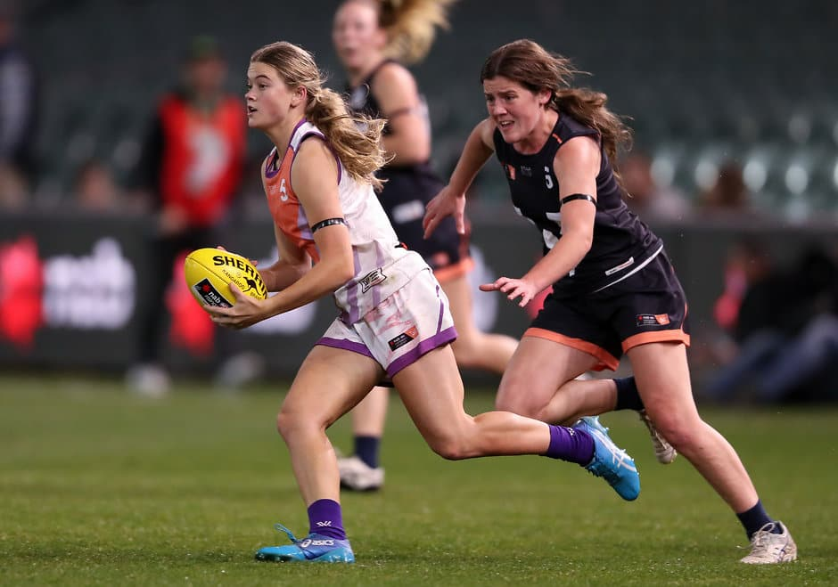 ADELAIDE, AUSTRALIA - AUGUST 31: Lily Postlethwaite of the All Stars being chased by Daisy Bateman of Victoria during the U18 AFLW Exhibition Match between the All Stars and Victoria at Adelaide Oval on August 31, 2018 in Adelaide, Australia. (Photo by AFL Media)