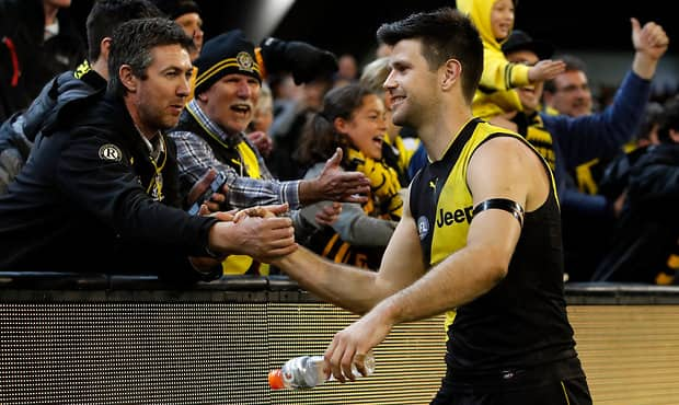 Richmond captain Trent Cotchin celebrates with the fans after last Thursday night's win over Hawthorn