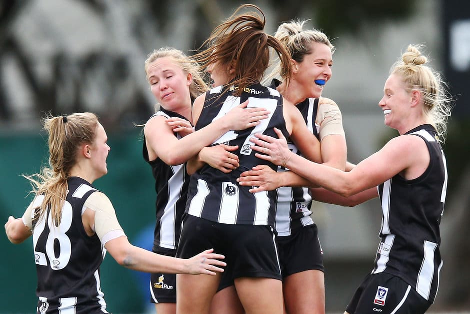 The Pies celebrate a goal during the 2018 VFLW preliminary final against Geelong - Collingwood Magpies