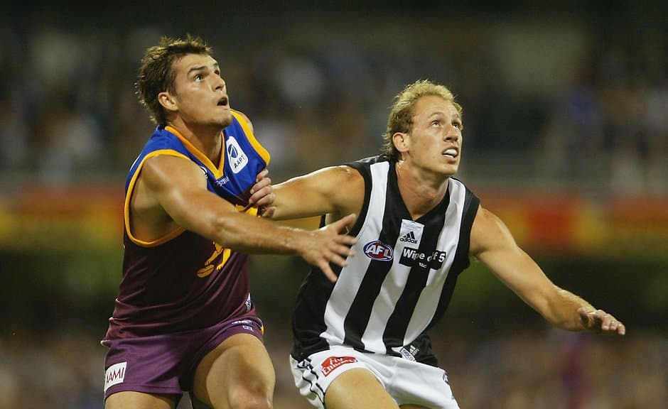 Jamie Charman and Josh Fraser compete for the ball during the Easter Thursday clash between Collingwood and Brisbane in 2004 - AFL,Fixture,Collingwood Magpies,Collingwood