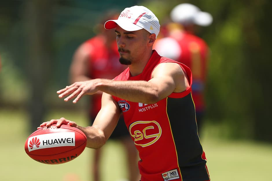 GOLD COAST, AUSTRALIA - NOVEMBER 26:  Izak Rankine kicks during a Gold Coast Suns AFL training session on November 26, 2018 in Gold Coast, Australia.  (Photo by Chris Hyde/Getty Images/AFL Media)