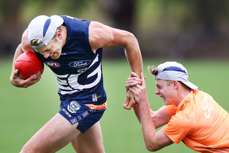 Rhys Stanley tries to break clear of a Zach Guthrie tackle - AFL,Geelong Cats,Rhys Stanley