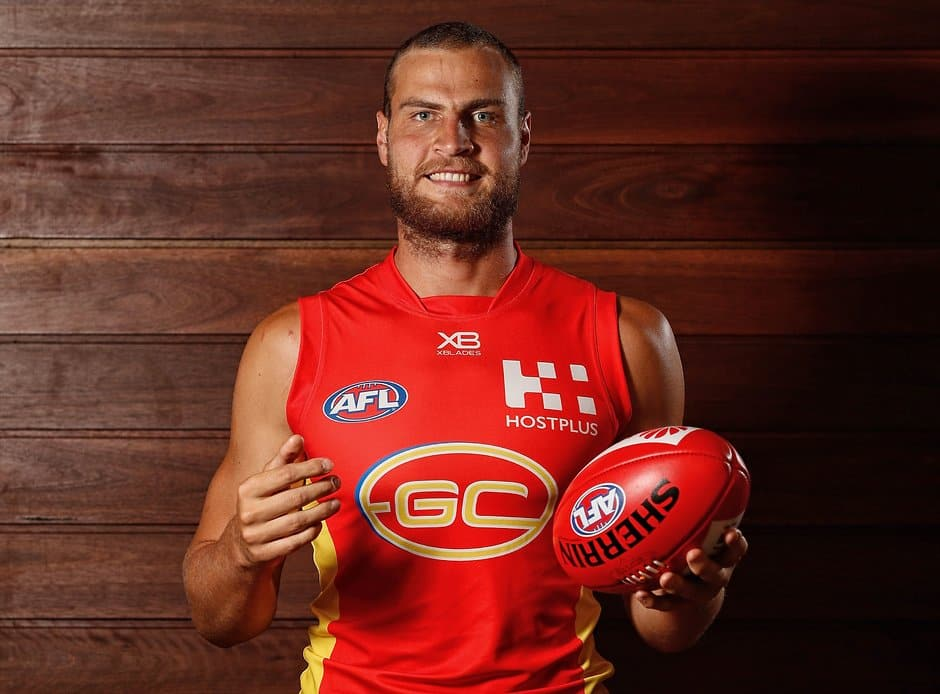GOLD COAST, AUSTRALIA - JANUARY 24: Jarrod Witts of the Suns poses for a photograph during the Gold Coast Suns 2019 official team photo day at Metricon Stadium on January 24, 2019 on the Gold Coast, Australia. (Photo by Michael Willson/AFL Media)