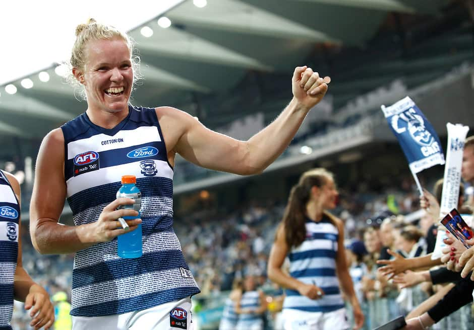 Kate Darby celebrates a win in round one with fans. - Geelong Cats