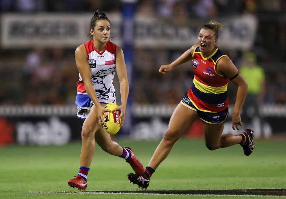 ADELAIDE, AUSTRALIA - FEBRUARY 02: Monique Conti of the Bulldogs evades Ebony Marinoff of the Crows during the 2019 NAB AFLW Round 01 match between the Adelaide Crows and the Western Bulldogs at Norwood Oval on February 02, 2019 in Adelaide, Australia. (Photo by AFL Media)