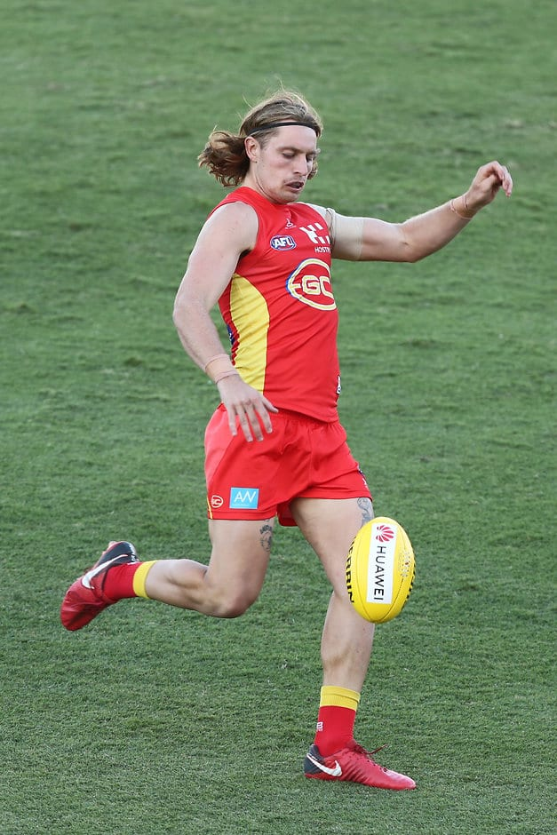 GOLD COAST, AUSTRALIA - FEBRUARY 23: Brad Scheer of the Suns kicks during the AFL pre-season practice match between the Gold Coast Suns and the Brisbane Lions at Metricon Stadium on February 23, 2019 in Gold Coast, Australia. (Photo by Chris Hyde/Getty Images)