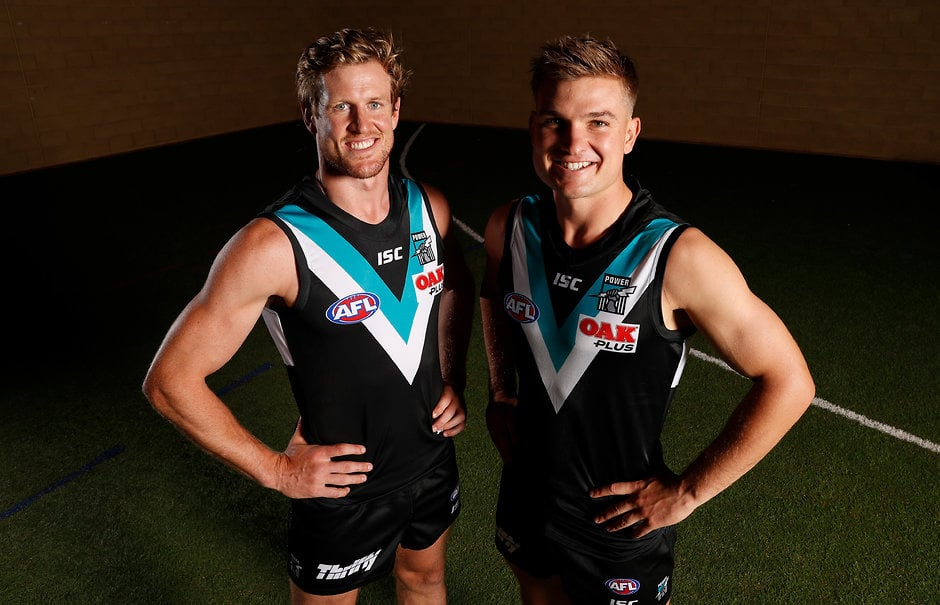 ADELAIDE, AUSTRALIA - FEBRUARY 27: 2019 Port Adelaide co-captains Tom Jonas (left) and Ollie Wines (right) pose for a photograph during the Port Adelaide Power 2019 official team photo day at Alberton on February 27, 2019 in Adelaide, Australia. (Photo by Michael Willson/AFL Media)