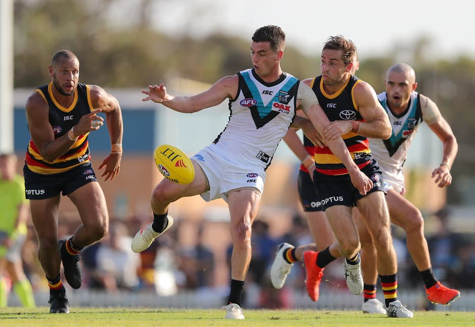 ADELAIDE, AUSTRALIA - MARCH 02 : Tom Rockliff of the Power is tackled by Richard Douglas of the Crows during the 2019 JLT Community Series match between the Adelaide Crows and the Port Adelaide Power at Memorial Oval on March 02, 2019 in Adelaide, Australia. (Photo by AFL Media)