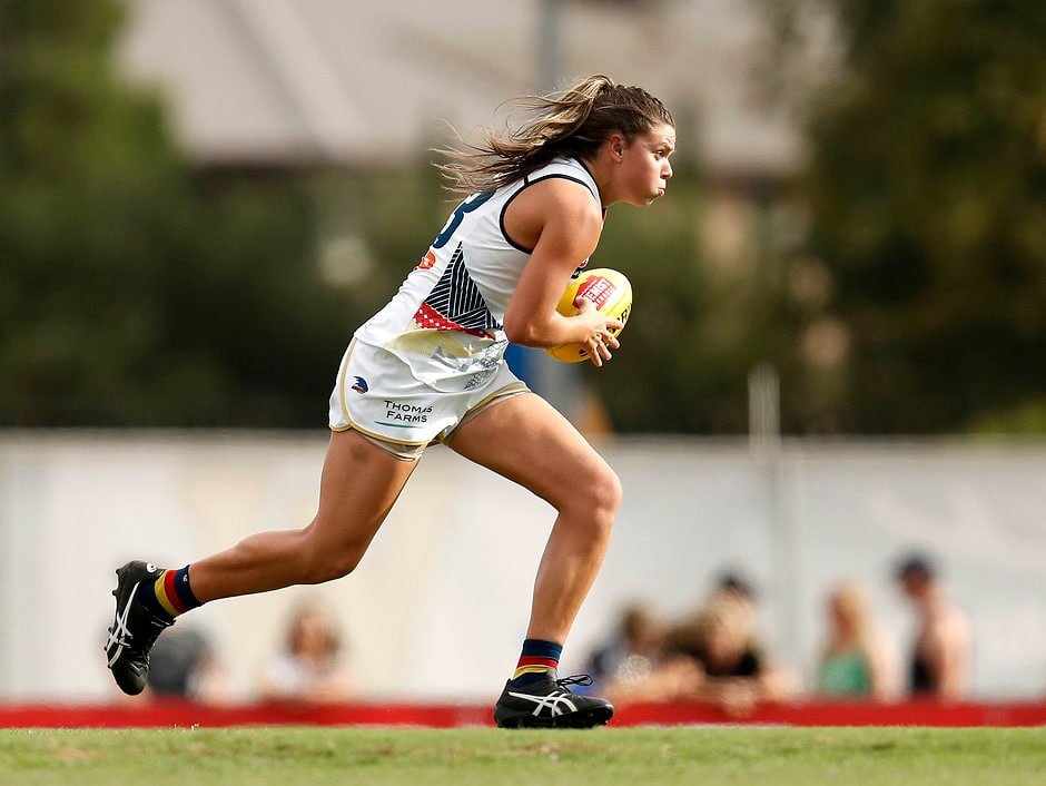 MELBOURNE, AUSTRALIA - MARCH 03: Anne Hatchard of the Crows runs with the ball during the 2019 NAB AFLW Round 05 match between the North Melbourne Tasmanian Kangaroos and the Adelaide Crows at Chirnside Park on March 03, 2019 in Melbourne, Australia. (Photo by Michael Willson/AFL Media)