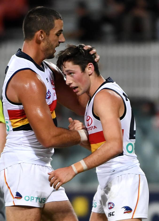 CANBERRA, AUSTRALIA - MARCH 08: Chayce Jones of the Crows celebrates a goal with Taylor Walker of the Crows during the 2019 JLT Community Series AFL match between the Greater Western Sydney Giants and the Adelaide Crows at UNSW Canberra Oval on March 08, 2019 in Canberra, Australia. (Photo by Tracey Nearmy/Getty Images)