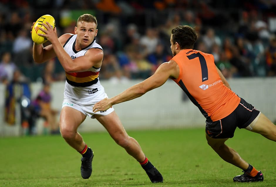 CANBERRA, AUSTRALIA - MARCH 08: Rory Laird of the Crows is tackled during the 2019 JLT Community Series AFL match between the Greater Western Sydney Giants and the Adelaide Crows at UNSW Canberra Oval on March 08, 2019 in Canberra, Australia. (Photo by Tracey Nearmy/Getty Images)