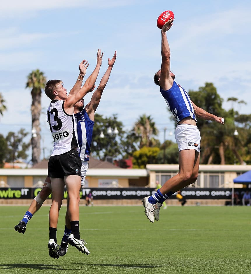 ADELAIDE, AUSTRALIA - MARCH 09 : Ben McKay of the Kangaroos intercepts the ball in front of team mate Ed Vickers-Willis and Todd Marshall of the Power during the 2019 JLT Community Series match between the Port Adelaide Power and the North Melbourne Kangaroos at Alberton Oval on March 09, 2019 in Adelaide, Australia. (Photo by AFL Media)