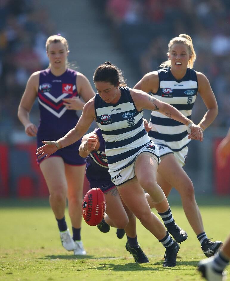 GEELONG, AUSTRALIA - MARCH 09: Julia Crockett-Grills of the Cats runs with the ball during the round six AFL match between the Geelong Cats and the Fremantle Dockers at GMHBA Stadium on March 09, 2019 in Geelong, Australia. (Photo by Scott Barbour/Getty Images)