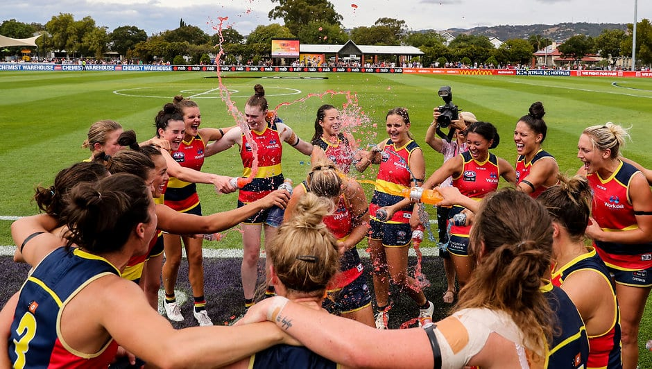ADELAIDE, AUSTRALIA - MARCH 10: Crows players celebrate victory with Nikki Gore in the middle during the 2019 NAB AFLW Round 06 match between the Adelaide Crows and the GWS Giants at Unley Oval on March 10, 2019 in Adelaide, Australia. (Photo by AFL Media)