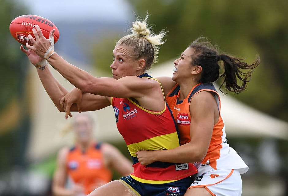 ADELAIDE, AUSTRALIA - MARCH 10: Erin Phillips of the Adelaide Crows marks in front of Rebecca Beeson of the Giantsduring the round six AFLW match between the Adelaide Crows and the Greater Western Sydney Giants at Unley Oval on March 10, 2019 in Adelaide, Australia. (Photo by Mark Brake/Getty Images)