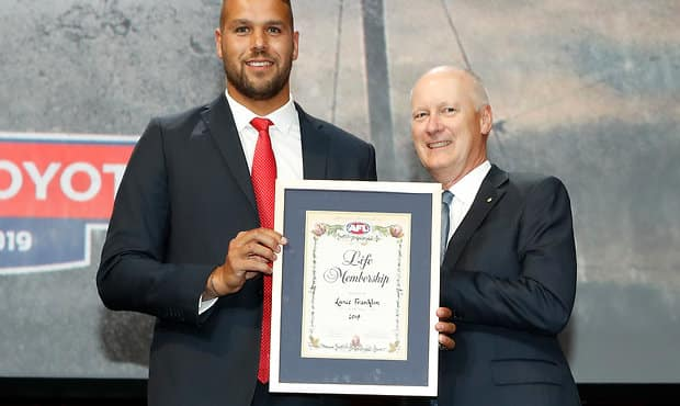 MELBOURNE, AUSTRALIA - MARCH 14: Lance Franklin of the Swans (left) is presented with his Life Membership by Richard Goyder, Chairman of the AFL (right) during the 2019 Toyota AFL Premiership Season Launch at Melbourne Town Hall on March 14, 2018 in Melbourne, Australia. (Photo by Michael Willson/AFL Media)