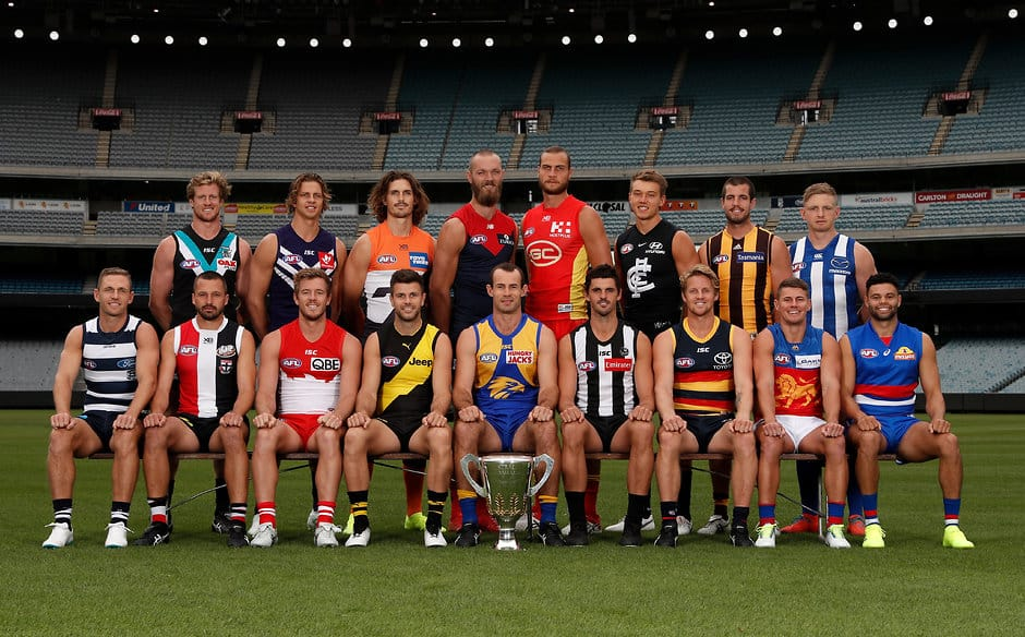 A selection of AFL leaders pose with the premiership cup - Collingwood Magpies
