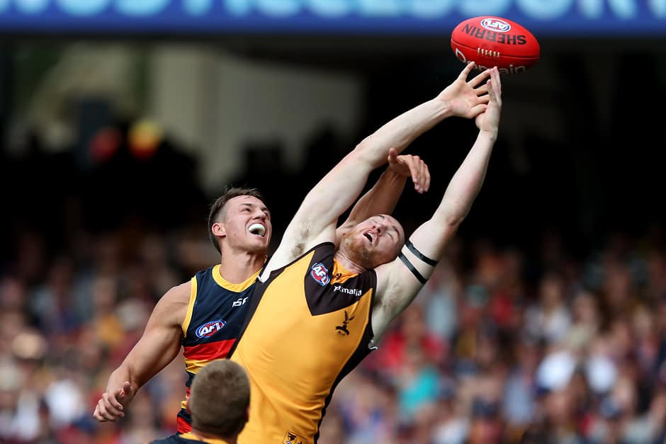 ADELAIDE, AUSTRALIA - MARCH 23: Tom Doedee of the Crows competes with Jarryd Roughead of the Hawks during the 2019 AFL round 01 match between the Adelaide Crows and the Hawthorn Hawks at Adelaide Oval on March 23, 2019 in Adelaide, Australia. (Photo by James Elsby/AFL Photos)