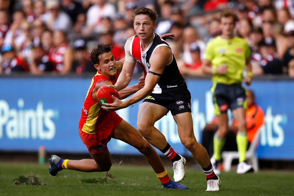 MELBOURNE, AUSTRALIA - MARCH 24: Jack Billings of the Saints is tackled by Wil Powell of the Suns during the 2019 AFL round 01 match between the St Kilda Saints and the Gold Coast Suns at Marvel Stadium on March 24, 2019 in Melbourne, Australia. (Photo by Dylan Burns/AFL Photos)