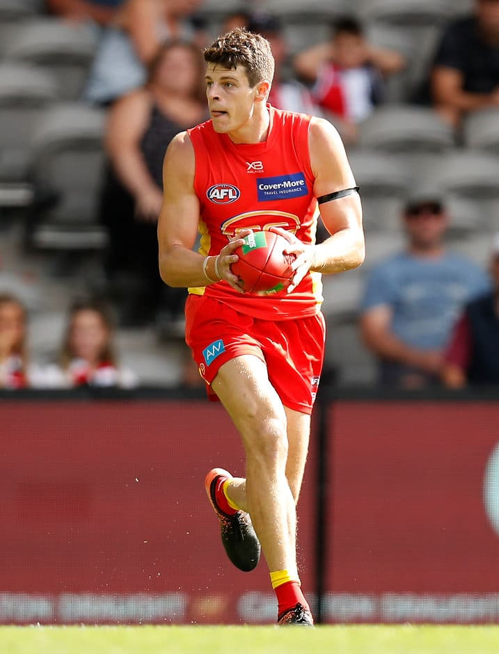 MELBOURNE, AUSTRALIA - MARCH 24: Chris Burgess of the Suns in action during the 2019 AFL round 01 match between the St Kilda Saints and the Gold Coast Suns at Marvel Stadium on March 24, 2019 in Melbourne, Australia. (Photo by Michael Willson/AFL Photos)