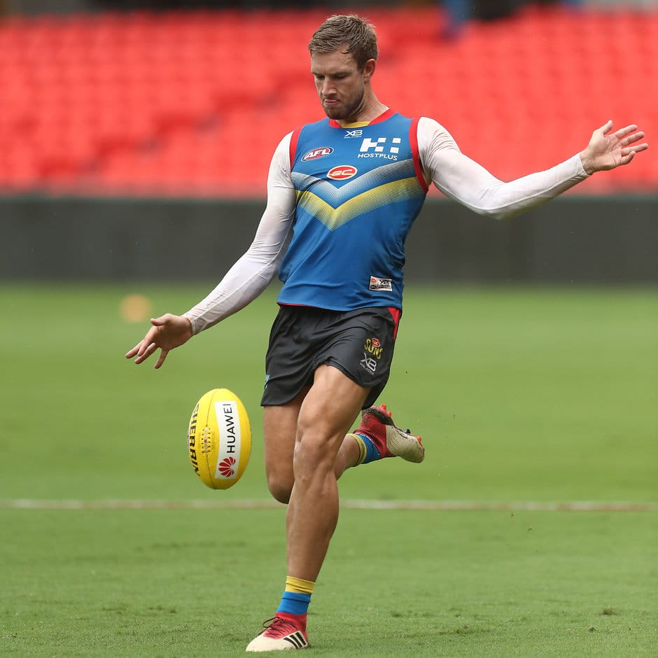 GOLD COAST, AUSTRALIA - MARCH 27: Sam Day kicks during a Gold Coast Suns AFL training session at Metricon Stadium on March 27, 2019 in Gold Coast, Australia. (Photo by Chris Hyde/Getty Images)