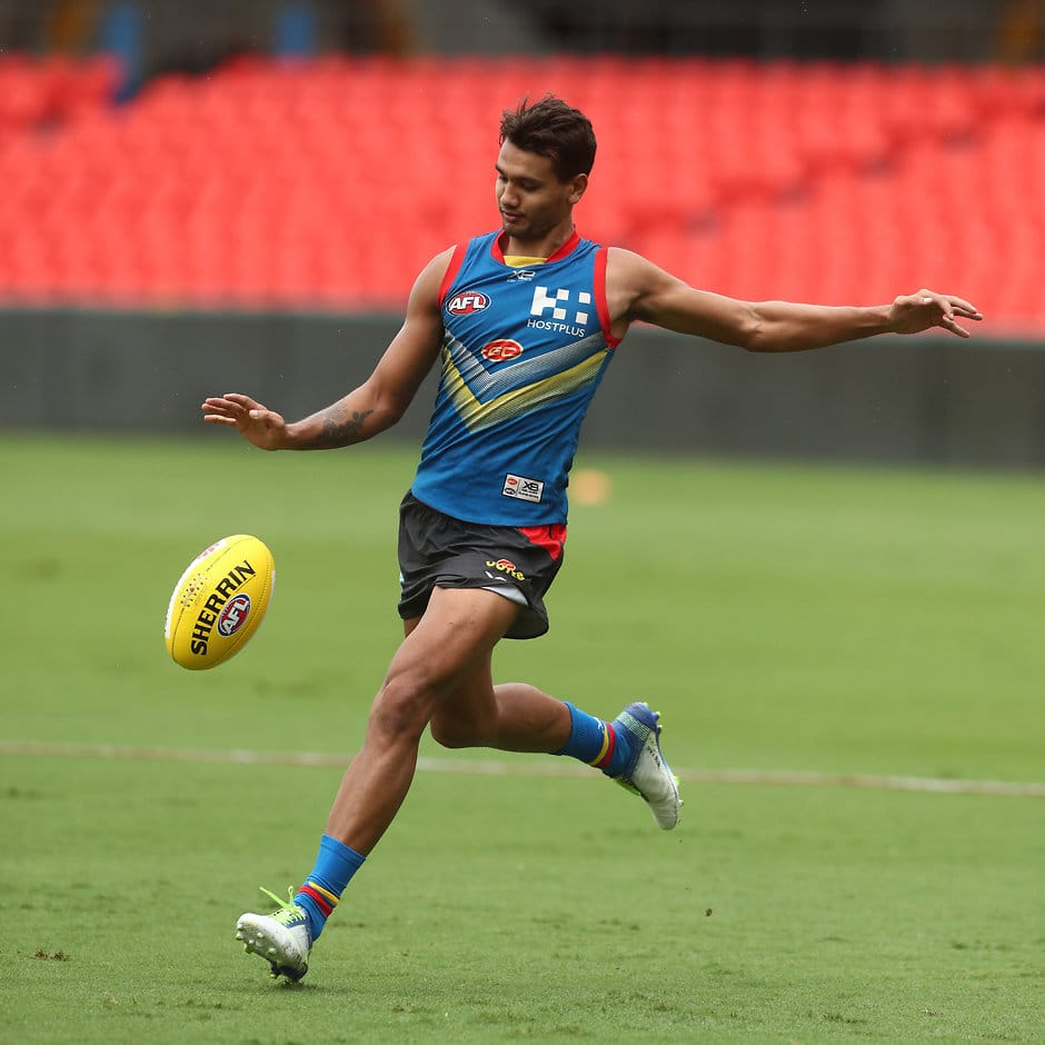 GOLD COAST, AUSTRALIA - MARCH 27: Callum Ah Chee kicks during a Gold Coast Suns AFL training session at Metricon Stadium on March 27, 2019 in Gold Coast, Australia. (Photo by Chris Hyde/Getty Images)