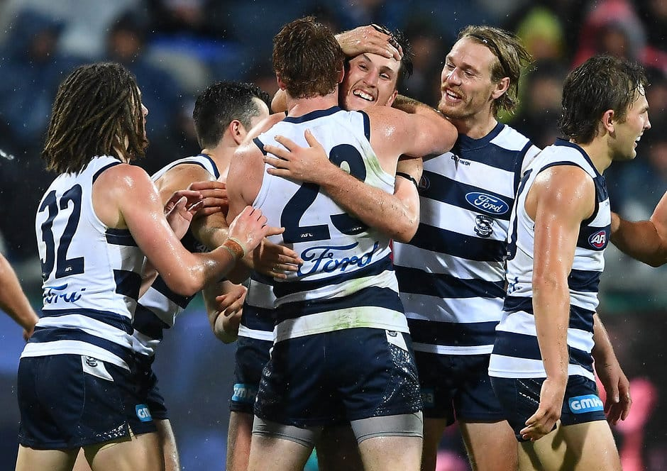 GEELONG, AUSTRALIA - MARCH 30: Charlie Constable of the Cats is congratulated by team mates after kicking a goal during the round two AFL match between the Geelong Cats and the Melbourne Demons at GMHBA Stadium on March 30, 2019 in Geelong, Australia. (Photo by Quinn Rooney/Getty Images)