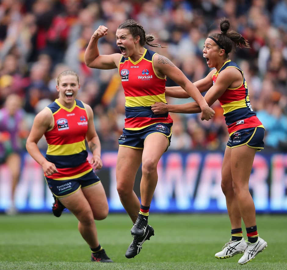 ADELAIDE, AUSTRALIA - MARCH 31: Anne Hatchard of the Crows celebrates a goal with team mate Justine Mules during the 2019 AFLW Grand Final match between the Adelaide Crows and the Carlton Blues at Adelaide Oval on March 31, 2019 in Melbourne, Australia. (Photo by AFL Photos)