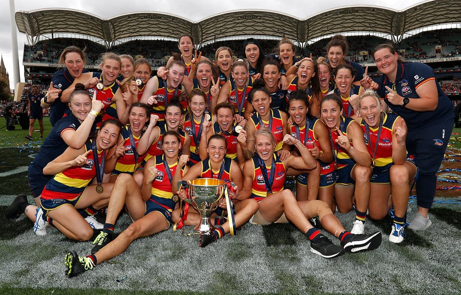 ADELAIDE, AUSTRALIA - MARCH 31: The Crows pose for a photograph with the premiership cup after winning the 2019 AFLW Grand Final match between the Adelaide Crows and the Carlton Blues at Adelaide Oval on March 31, 2019 in Melbourne, Australia. (Photo by Michael Willson/AFL Photos)