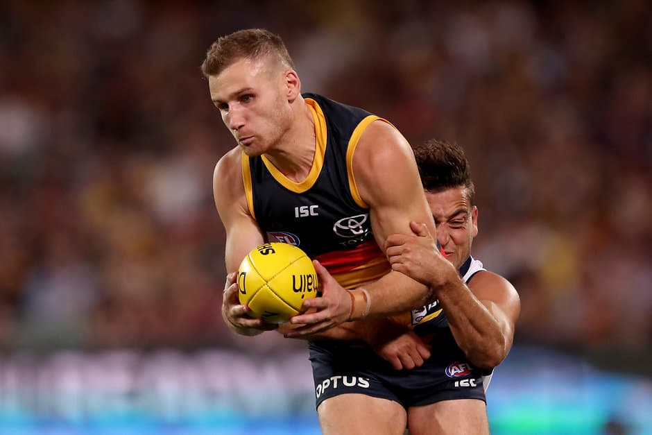 ADELAIDE, AUSTRALIA - APRIL 04: Rory Laird of the Crows is tackled by Luke Dahlhaus of the Cats during the 2019 AFL round 03 match between the Adelaide Crows and the Geelong Cats at Adelaide Oval on April 04, 2019 in Adelaide, Australia. (Photo by James Elsby/AFL Photos)