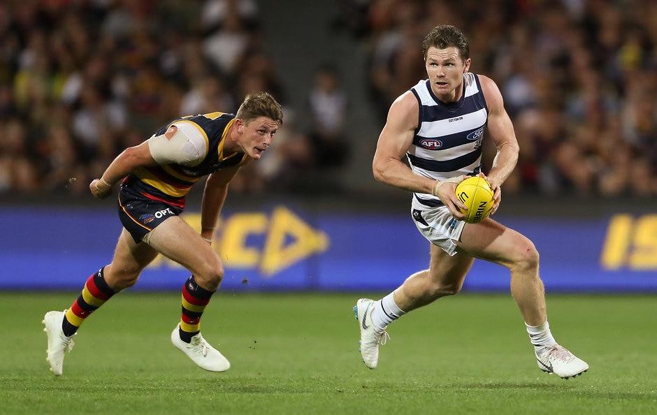Patrick Dangerfield bursts away from a stoppage. - Geelong Cats,Tom Stewart,Patrick Dangerfield