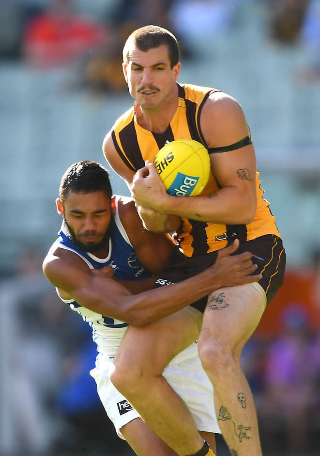 MELBOURNE, AUSTRALIA - APRIL 07: Ben Stratton of the Hawks marks infront of Tarryn Thomas of the Kangaroos  during the round three AFL match between the Hawthorn Hawks and the North Melbourne Kangaroos at Melbourne Cricket Ground on April 07, 2019 in Melbourne, Australia. (Photo by Quinn Rooney/Getty Images)