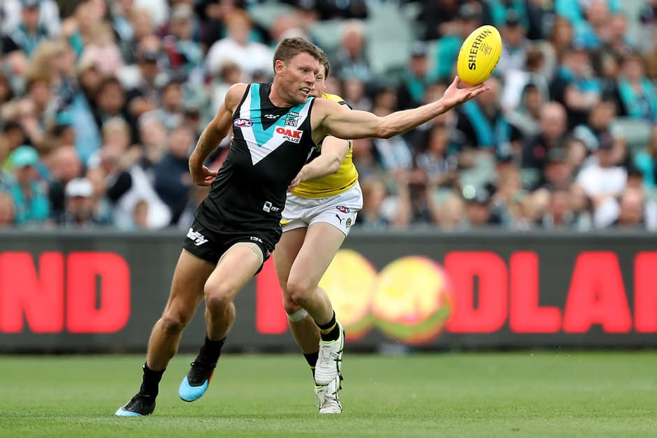 ADELAIDE, AUSTRALIA - APRIL 13: Brad Ebert of the Power is tackled by Dylan Grimes of the Tigers during the 2019 AFL round 04 match between the Port Adelaide Power and the Richmond Tigers at Adelaide Oval on April 13, 2019 in Adelaide, Australia. (Photo by James Elsby/AFL Photos)