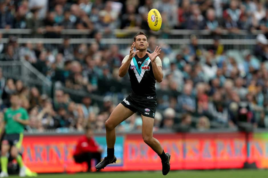 ADELAIDE, AUSTRALIA - APRIL 13: Steven Motlop of the Power marks the ball during the 2019 AFL round 04 match between the Port Adelaide Power and the Richmond Tigers at Adelaide Oval on April 13, 2019 in Adelaide, Australia. (Photo by James Elsby/AFL Photos)