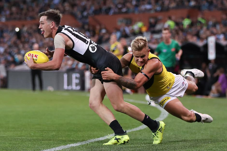 ADELAIDE, AUSTRALIA - APRIL 13: Zak Butters of the Power is tackled by Brandon Ellis of the Tigers during the 2019 AFL round 04 match between the Port Adelaide Power and the Richmond Tigers at Adelaide Oval on April 13, 2019 in Adelaide, Australia. (Photo by AFL Photos)