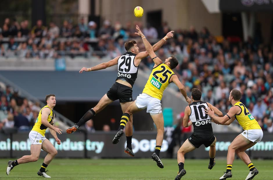 ADELAIDE, AUSTRALIA - APRIL 13: Scott Lycett of the Power and Toby Nankervis of the Tigers compete in a ruck contest during the 2019 AFL round 04 match between the Port Adelaide Power and the Richmond Tigers at Adelaide Oval on April 13, 2019 in Adelaide, Australia. (Photo by AFL Photos)