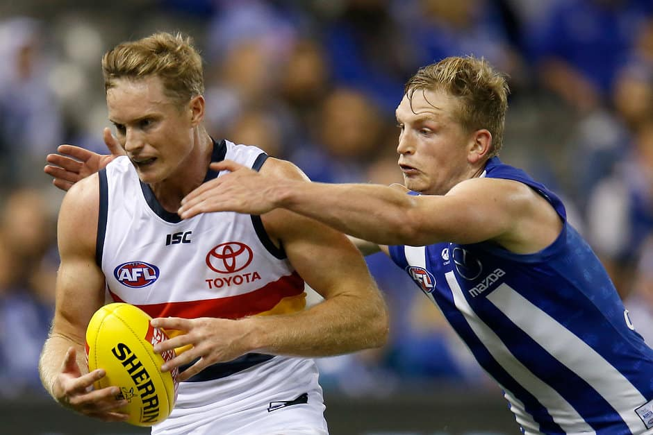 MELBOURNE, AUSTRALIA - APRIL 13: Alex Keath of the Adelaide Crows is tackled by Jack Ziebell of the Kangaroos during the 2019 AFL round 04 match between the North Melbourne Kangaroos and the Adelaide Crows at Marvel Stadium on April 13, 2019 in Melbourne, Australia. (Photo by Darrian Traynor/AFL Photos)