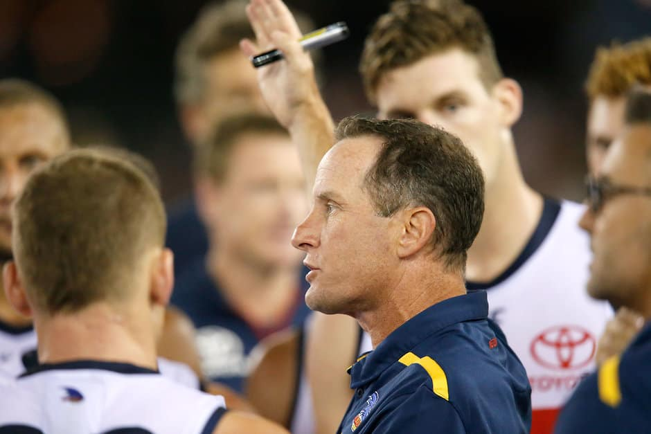 MELBOURNE, AUSTRALIA - APRIL 13:A Adelaide Crows senior coach Don Pyke speaks to his players during the 2019 AFL round 04 match between the North Melbourne Kangaroos and the Adelaide Crows at Marvel Stadium on April 13, 2019 in Melbourne, Australia. (Photo by Darrian Traynor/AFL Photos)