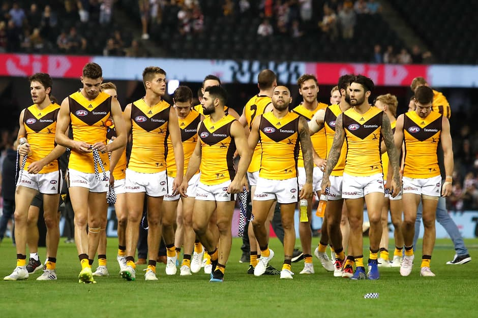 The Hawks trudge off the ground after being overrun by the Saints last week - AFL,Hawthorn Hawks,Alastair Clarkson