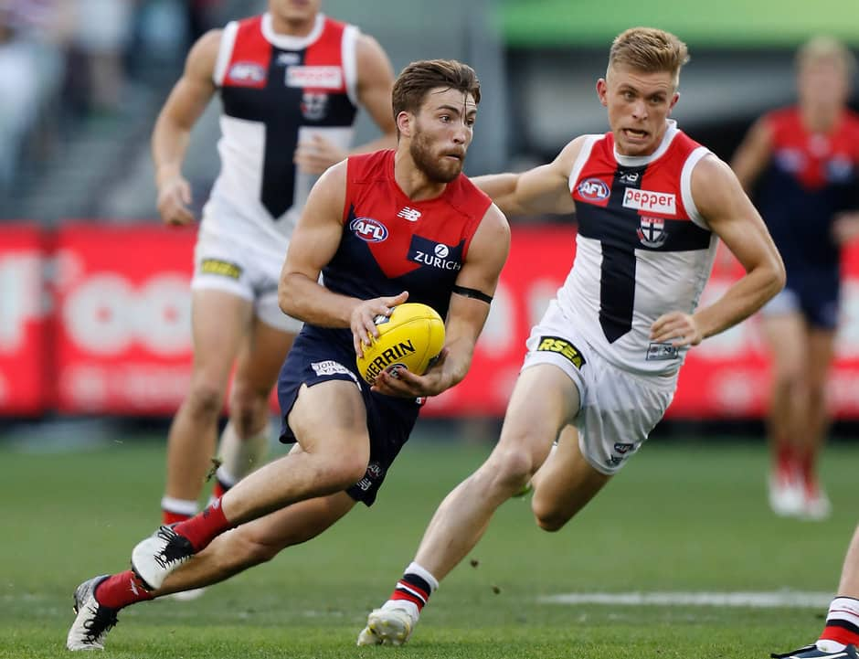 MELBOURNE, AUSTRALIA - APRIL 20: Jack Viney of the Demons is chased by Sebastian Ross of the Saints during the 2019 AFL round 05 match between the Melbourne Demons and the St Kilda Saints at the Melbourne Cricket Ground on April 20, 2019 in Melbourne, Australia. (Photo by Michael Willson/AFL Photos)