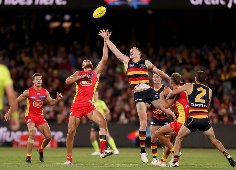 ADELAIDE, AUSTRALIA - APRIL 21: Reilly O'Brien of the Crows clashes with Jarrod Witts of the Suns during the 2019 AFL round 05 match between the Adelaide Crows and the Gold Coast Suns at the Adelaide Oval on April 21, 2019 in Melbourne, Australia. (Photo by James Elsby/AFL Photos)