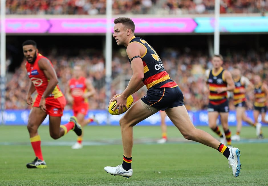 ADELAIDE, AUSTRALIA - APRIL 21: Brodie Smith of the Crows on his way to kicking a goal during the 2019 AFL round 05 match between the Adelaide Crows and the Gold Coast Suns at the Adelaide Oval on April 21, 2019 in Melbourne, Australia. (Photo by AFL Photos)