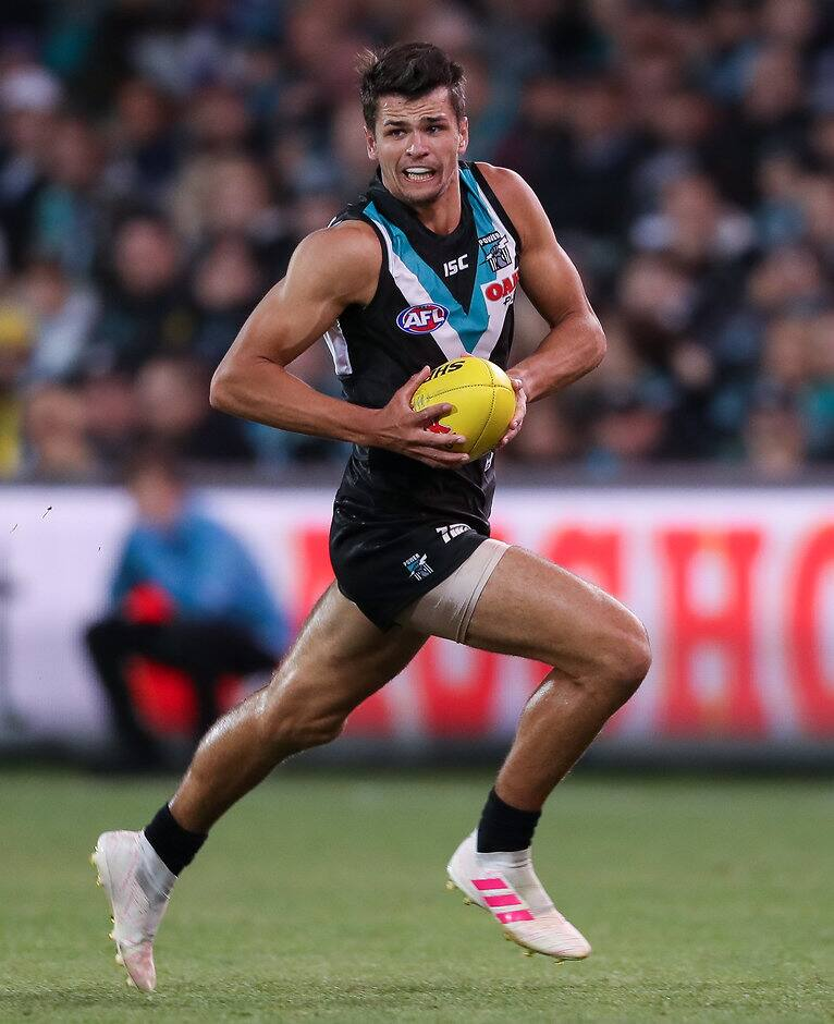 ADELAIDE, AUSTRALIA - APRIL 26: Ryan Burton of the Power in action during the 2019 AFL round 06 match between the Port Adelaide Power and the North Melbourne Kangaroos at Adelaide Oval on April 26, 2019 in Adelaide, Australia. (Photo by Matt Turner/AFL Photos)