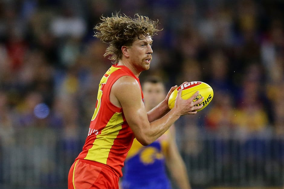 PERTH, AUSTRALIA - MAY 04: Aaron Young of the Suns looks to pass the ball during the 2019 AFL round 07 match between the West Coast Eagles and the Gold Coast Suns at Optus Stadium on May 04, 2019 in Perth, Australia. (Photo by Will Russell/AFL Photos)