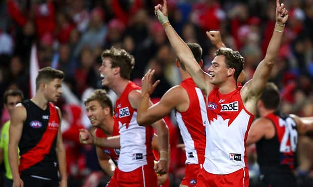 SYDNEY, AUSTRALIA - MAY 10: Will Hayward of the Swans and team mates celebrate winning the round eight AFL match between the Sydney Swans and the Essendon Bombers at Sydney Cricket Ground on May 10, 2019 in Sydney, Australia. (Photo by Cameron Spencer/AFL Photos/Getty Images)