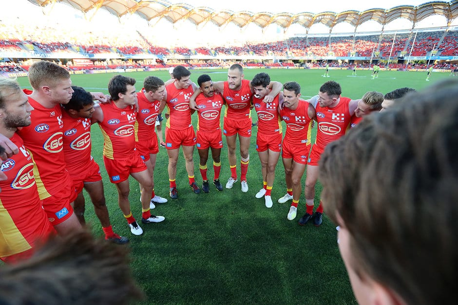 GOLD COAST, AUSTRALIA - MAY 11: Jarrod Witts (center) of the Suns talks to his team during the round eight AFL match between the Gold Coast Suns and the Melbourne Demons at Metricon Stadium on May 11, 2019 in Gold Coast, Australia. (Photo by Jono Searle/AFL Photos/Getty Images)